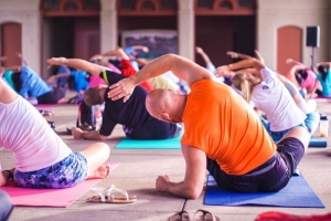 Many different people practicing Yoga